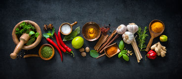 Various herbs and spices. On dark background stock photo