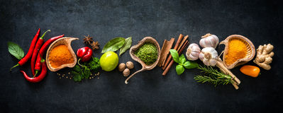 Various herbs and spices. On dark background stock photos