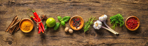 Various herbs and spices. On wooden table stock photo