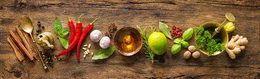 Various herbs and spices. On wooden table royalty free stock photography