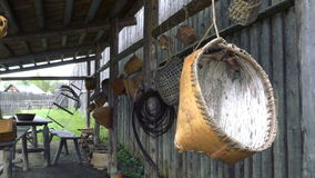 Colonial Era Items Hanging From Beams stock footage