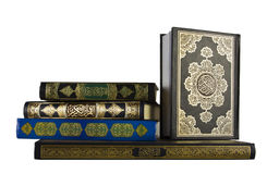 Various holy Quran books. Isolated in white Stock Image