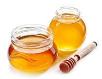 Various honey jars Stock Images