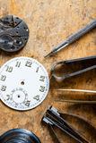 Various horologists tools with a clock dial Royalty Free Stock Image