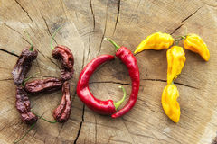 Various hot peppers spelling the word HOT Royalty Free Stock Image