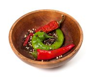 Various of hot peppers in wooden plate Royalty Free Stock Images