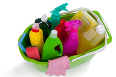 Various household cleaning supplies in a bucket Royalty Free Stock Images
