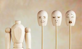 Various human emotions and mood. Abstract image with a wooden puppet Royalty Free Stock Photos