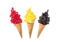 Various of ice cream flavor in cones  frozen berries. Mango, pineapple,  red and black currant on white background.  Summer creative concept Royalty Free Stock Photography