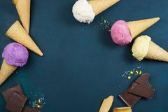 Various ice cream scoops, wafer cones, chocolate and sugar sprin stock photography