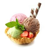 Various ice cream scoops in waffle basket royalty free stock photo