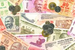 Various indian banknotes and coins illustrating indian economy stock images