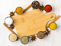 Various Indian spices in metal cups. Empty wooden Board, seasoni Royalty Free Stock Photo