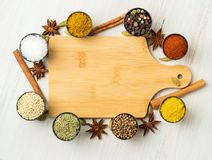 Various Indian spices in metal cups. Empty wooden Board, seasoni Royalty Free Stock Photography