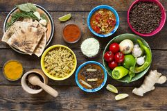 Various Indian and vegetarian dishes and snacks. Traditional food wooden background Stock Photography