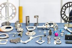 Various of industrial metal parts manufacture from forcing bending casting and machining such as flank plate holder sprocket on royalty free stock image