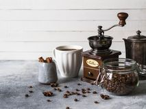 Various ingredients for making coffee, Glass jar with coffee beans, sugar, vintage coffeepot, coffee grinder, cup with coffee and royalty free stock photos