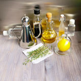 Various ingredients for salad dressing: oil, olive oil, vinegar, grape vinegar, wine vinegar, balsamic or soy sauce, fresh lemon, Royalty Free Stock Photo