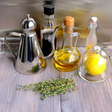 Various ingredients for salad dressing: oil, olive oil, vinegar, grape vinegar, wine vinegar, balsamic or soy sauce, fresh lemon, Royalty Free Stock Images