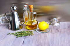 Various ingredients for salad dressing: oil, olive oil, vinegar, grape vinegar, wine vinegar, balsamic or soy sauce, fresh lemon, Stock Images