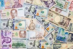 Various international foreign currency banknotes background. International trade, money cross border concept.  stock photography