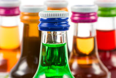 Various isolated liqueur bottles with party drinks Stock Images