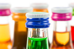 Various isolated liqueur bottles with party drinks Royalty Free Stock Images