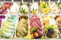 Various italian gelato ice cream flavours in modern shop display. Window stock photos