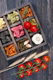 Various Italian pasta cherry tomatoes in vintage wooden box Stock Photo