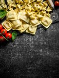 Various Italian raw pasta. On dark rustic background stock photography