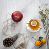 Various items for gift wrapping are on table. Cup of Tea with Lemon. Royalty Free Stock Images