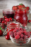 Various jams and berries Stock Photography