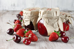 Various jams and berries Stock Images
