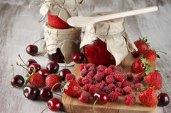 Various jams and berries Stock Image