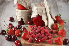 Various jams and berries Royalty Free Stock Images