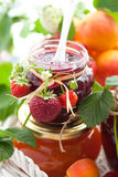 Various jams  in jars. Strawberry,apricot, raspberry jam in a jars and fresh berries Royalty Free Stock Photography