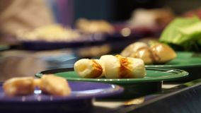 Various japanese food in a conveyor belt at restaurant stock footage