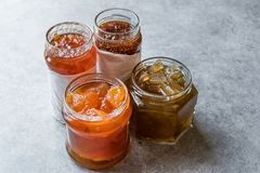 Various Jar of Fruit Jams Fig, Quince, Bergamot Citrus and Watermelon Peel Marmalade. Organic Food royalty free stock images