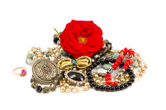 Various jewellery with red rose  on white Stock Image