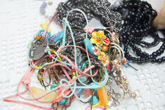 Various jewelry necklaces and bracelets stock photography