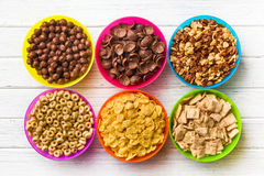 Various kids cereals in colorful bowls Royalty Free Stock Image