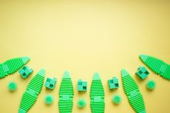 Various kids toys background in green colours, yellow background royalty free stock image