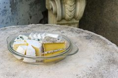 Various kind of cheese served on stone table in vintage exterior stock photos