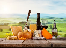 Various kind of cheese served on wood stock photography