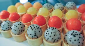 Various kind of fruits in round shape, on pastry cups stock photos