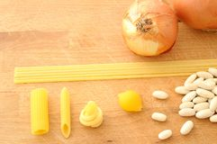Various kind of italian pasta, beans and onion from above stock image