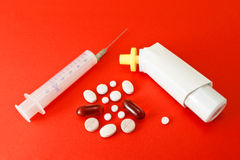 Various kind of medicine. On the red background royalty free stock photos