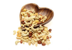 Various kind of nuts in a heart shaped plate Stock Photos