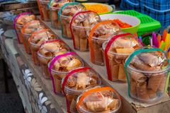 Various kind of Thai desserts presented in plastic pack for sell in Thailand royalty free stock photography