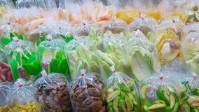 Various kind of Thai packed fruits ready to serve. stock photos